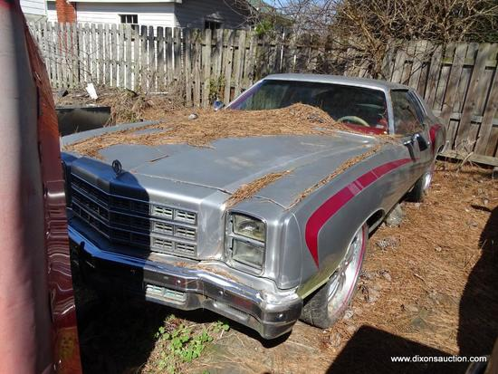 1977 SILVER MONTE CARLO; VIN 1H57U7B587408. SILVER WITH RED STRIPES. THIS CAR WAS ABANDONED AT A