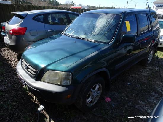GREEN HONDA CR-V; VIN JHLRD1861009196. 240,811 MILES. THIS CAR WAS ABANDONED AT A HOME DEPOT. NO