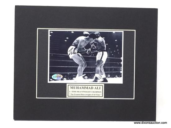 HAND SIGNED MUHAMMAD ALI MATTED PHOTO WITH CERTIFICATE OF AUTHENTICITY. MEASURES 10 IN X 8 IN.