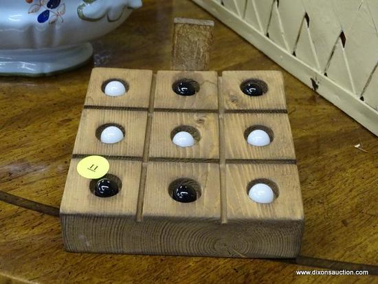 (R1) WOOD AND MARBLES TIC-TAC-TOE GAME; SQUARE WOODEN CASE WITH ROTATING PANEL TO HOLD 10 BLACK OR
