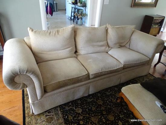 (LR) CLASSICS BY SWAIM 3-CUSHION PILLOW BACK SOFA; LOVELY BEIGE UPHOLSTERY WITH TAN ROPED TRIM.