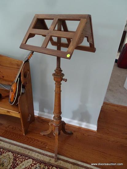 (LR) VINTAGE CARVED WOODEN MUSIC STAND; LIGHT TO MEDIUM OAK FINISH, ADJUSTABLE, WITH ORNATELY CARVED