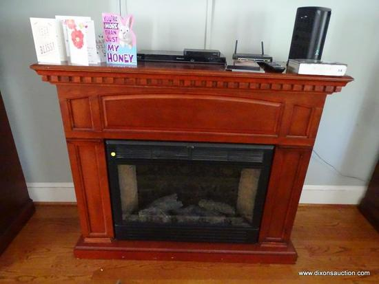 (LR) TWIN STAR HOME ELECTRIC FIREPLACE UNIT; MODEL #33E01, 120 VAC, 12 AMPS, 60 HZ. RICH WOOD GRAIN