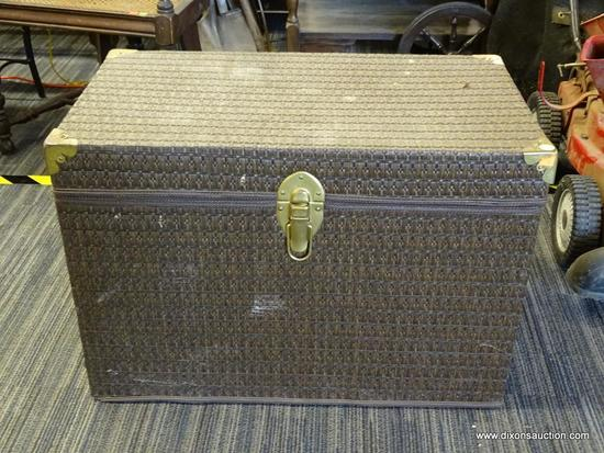 TRUNK; HAS A BROWN WOVEN STYLE EXTERIOR AND BRASS HARDWARE. MEASURES 28 IN X 16 IN X 20 IN. IS IN