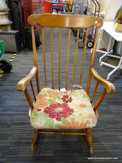 ROCKING CHAIR; MAPLE STRAIGHT BACK AND SPINDLE TURNED LEGGED ROCKING CHAIR. MEASURES 26 IN X 28 IN X
