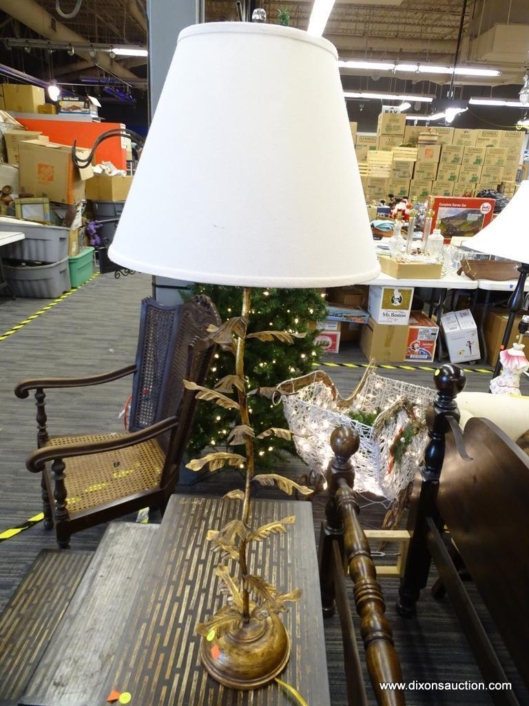 TABLE LAMP; GOLD TONED TABLE LAMP IN THE FORM OF A LEAF PLANT WITH A WHITE BELL SHAPED SHADE AND