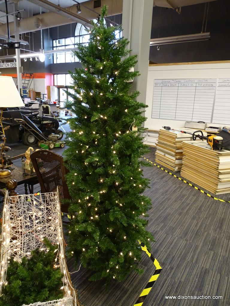 PRE-LIT CHRISTMAS TREE; 6 FT 8 IN TALL GREEN CHRISTMAS TREE WITH WHITE LIGHTS. IS IN EXCELLENT