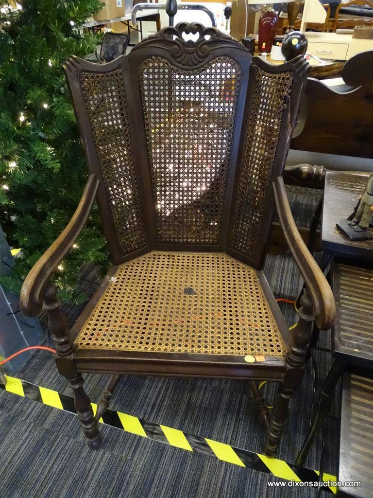 ANTIQUE TRIPLE PANEL CANE WINGBACK CHAIR; WOODEN CARVED FRAME WITH PATTERNED CREST, 3 PANELED BACK