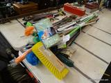 ASSORTED MOPS AND BROOMS BUNDLE LOT; ABOUT 12 TOTAL PIECES. INCLUDES PLASTIC AND WOOD HANDLES, WITH