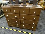 DRESSER; 10 DRAWER DRESSER WITH PORCELAIN KNOBS. MEASURES 42.5 IN X 15 IN X 32 IN