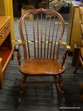 VINTAGE BOW BACK ROCKING CHAIR; THIS ROCKING CHAIR HAS A CARVED DETAILED TOP, BOW BACK, ROLLED ARMS,