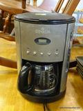 GEVALIA COFFEE MAKER; BLACK AND BRUSHED CHROME PROGRAMMABLE 12 CUP COFFEEMAKER. MODEL CM500.