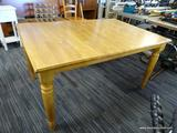 WOOD GRAIN DINING TABLE; RECTANGULAR TOP WITH AREA TO ADD A LEAF (NOT INCLUDED). SITS ON 4 TURNED