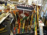 LOT OF ASSORTED HAND TOOLS; LOT INCLUDES 18 DIFFERENT TOOLS SUCH AS A PITCH FORK, BROOM, A RAKE, A