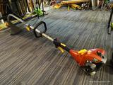 HOMELITE WEEDEATER; GAS POWERED RED AND BLACK EDGE TRIMMER/WEEDEATER. MIGHTY LITE 26VT MODEL