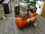 SEARS AIR COMPRESSOR; DOUBLE CYLINDER AIR COMPRESSOR WITH 1 HP ENGINE AND IS ON WHEELS FOR EASY