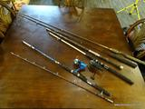 LOT OF FISHING POLES; INCLUDES 2 SHAKESPEARE TIGER POLE LOWER HALVES WITH OPEN FACE REELS, A CORK