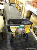 SCOTTS LAWN SPREADER; MODEL PRO EDGE-GUARD. BLACK IN COLOR. GREAT FOR FERTILIZER, SEED, AND MORE!