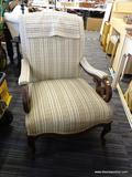 ARM CHAIR; HAS FLORAL STRIPED UPHOLSTERY AND MAHOGANY BONES. HAS ARM SLIPCOVERS. MEASURES 26 IN X 35