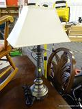 BRUSHED METAL TABLE LAMP; THIS TABLE LAMP HAS WHITE FABRIC SHADE THAT SITS ON A BRUSHED GUNMETAL