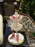 TABLE LAMP; IN THE FORM OF A LADIES FLORAL DRESS WITH A PAIR OF PINK LADIES SHOES ACCENTS. MEASURES