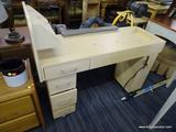NAIL TECHNICIAN STATION; BLONDE WOOD GRAIN DESK/WORKSTATION USED IN A NAIL SALON. THIS PIECE HAS A 3