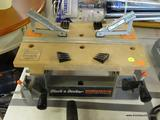 BLACK & DECKER WORKMATE; GREY AND TAN WORKMATE BENCH TOP WORK CENTER & VISE. HAS TILT TOP. 16 IN
