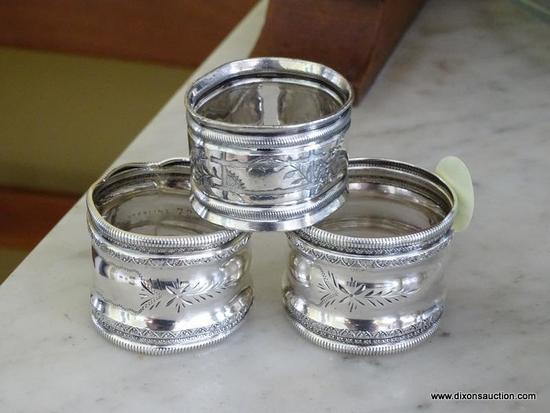"""(DR) VINTAGE NAPKIN RINGS; TOTAL OF 3. TWO ARE MARKED """"STERLING 72"""" ON INSIDE, OTHER IS HEAVIER THAN"""