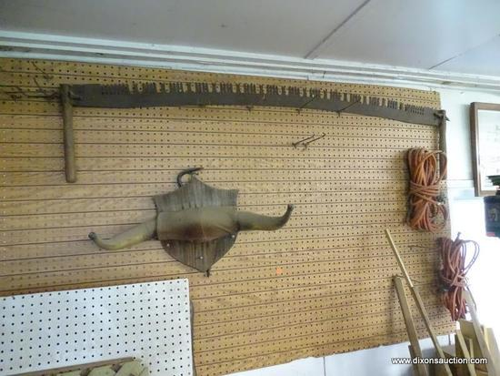(WSHOP) CONTENTS OF WALL; INCLUDES A SET OF BULL HORNS, AN ANTIQUE 2 MAN WOOD SAW, AND 2 ELECTRICAL