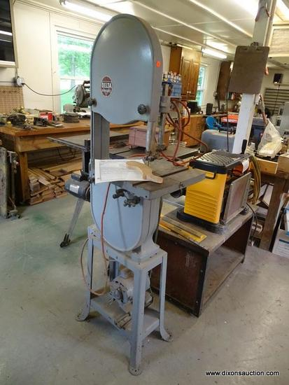 (WSHOP) BAND SAW; MADE BY DELTA MILWAUKEE. CIRCA LATE 1940'S. SERIAL #56-2035. IS IN GOOD USED