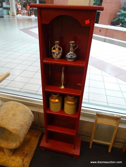 RED BOOKCASE; HAS 6 SHELVES TOTAL AND IS IN VERY GOOD CONDITION. MEASURES 14 IN X 9 IN X 51 IN.