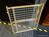 ADJUSTABLE BABY GATE; MADE OF MAPLE AND HARD PLASTIC AND IS IN EXCELLENT CONDITION!