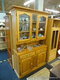 SOLID OAK HUTCH/BUFFET COMBO; IS 2 PIECES. HAS CROWN MOLDING, 2 UPPER GLASS DOORS WITH A CENTER