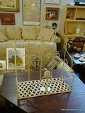 WROUGHT IRON WALL HANGING SHELF; HAS A FLORAL MOTIF AND LATTICE BOTTOM. MEASURES 20 IN X 9 IN X 28