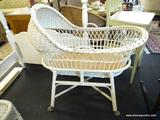BABY BASSINET; WICKER BASSINET WITH WOODEN INNER BOTTOM AND WICKER BASE ON WHEELS. TOP IS REMOVABLE.