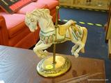 WILLITTS DESIGNS CAROUSEL HORSE FIGURINE; MOUNTED ON A BRASS BASE AND MEASURES 8 IN TALL