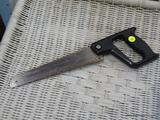 COMPASS SAW; HAND SAW WITH BLACK HANDLE AND PHILLIPS HEAD SCREWS HOLDING THE BLADE.