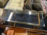 GLASS AND WOOD CONSOLE TABLE; HAS A 1 IN BEVELED GLASS TOP AND PINE BASE WITH BRASS ACCENTS.