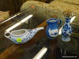 3 PIECE LOT; INCLUDES A DELFT BUD VASE, A BLUE AND WHITE FLORAL PATTERN SINGLE HANDLED WATER POURER,