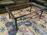 RECTANGULAR COFFEE TABLE; TAKES A GLASS INSERT AND HAS PAW STYLE FEET. HAS A BRONZED TONED RIM WITH