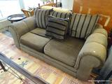 GRAMERCY HILL LOVESEAT; IS BROWN IN COLOR WITH ROLLED ARMS AND BROWN AND BLACK STRIPED PILLOWS.
