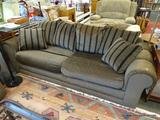 GRAMERCY HILL 2 CUSHION SOFA; IS BROWN IN COLOR WITH ROLLED ARMS AND BROWN AND BLACK STRIPED