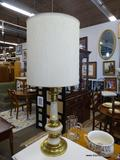 TABLE LAMP; 1 OF A PAIR OF GOLD AND CREAM TONED TABLE LAMPS WITH TALL ROUND SHADES AND BRASS