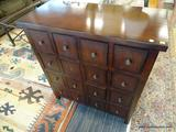 16 DRAWER STORAGE CABINET; MAHOGANY CABINET WITH SILVER TONED PULLS. MEASURES 35 IN X 16 IN X 38 IN