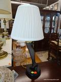 LEGGING LAMP; IN THE FORM OF A LADIES LEG WITH LACED STOCKING AND A HIGH HEEL SHOE. HAS SHADE AND