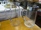 PAIR OF GLASS PITCHERS; PAIR OF GLASS PITCHERS WITH HANDLES. ONE PITCHER HAS A STAINLESS STEEL RIM.