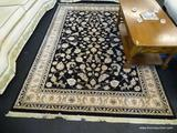 KARASTAN AREA RUG; PERSIAN RENAISSANCE #39 AREA RUG IN BLACK, CREAM AND GREEN. MEASURES 5 FT 3 IN X