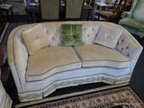 2 CUSHION LOVESEAT; MADE BY WATERS FURNITURE CO. IS CREAM IN COLOR WITH GREEN TRIM AND FLORAL