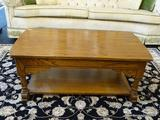 COFFEE TABLE; OAK COFFEE TABLE WITH 1 LOWER SHELF AND EXTENDABLE TOP FOR EASE OF ACCESS TO REMOTES,