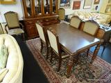 DINING ROOM SET; INCLUDES A TABLE AND 6 CHAIRS. TABLE HAS A 3 IN BANDED TOP WITH SHERATON STYLE LEGS
